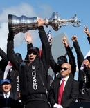 Jimmy Spithill raises the America's Cup after coming back from 8-1 down to defeat Team New Zealand in 2013. Photo / Brett Phibbs