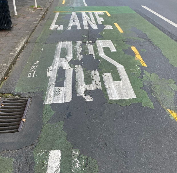 The paint on the Khyber Pass Rd bus and transit lane in Newmarket is peeling off from wear. SUPPLIED