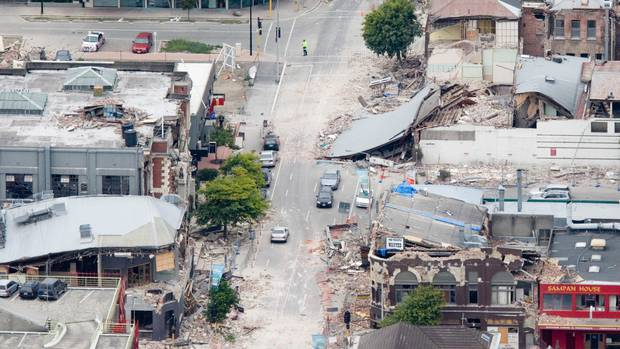 Damaged buildings in the central city on the evening of the February 22, 2011 Christchurch earthquake. Photo / Mark Mitchell