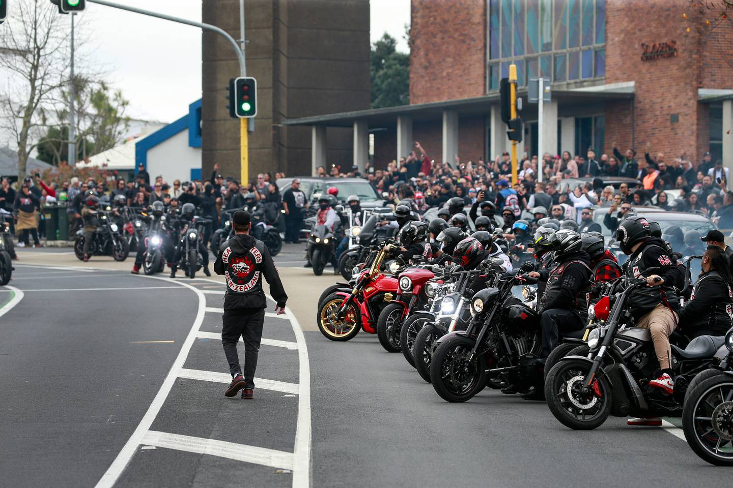 More than 300 mourners attended the funeral of Taranaki Fuimaono, a Head Hunters gang member who died shortly after being taken into police custody in June. Photo / Alex Burton
