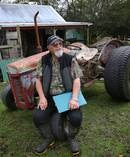 Lotto winner Lou Te Keeti still has his old gumboots and rusty 1950s tractor. Photo: John Borren