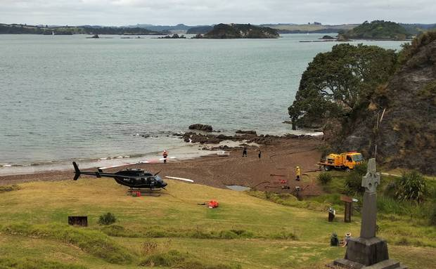 A Salt Air helicopter from Paihia and a Rural Fire appliance from Kaikohe at Rangihoua Bay the following morning, with Marsden Cross on the right. Photo / Supplied