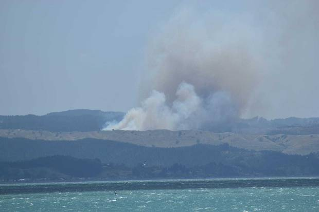 Smoke is spreading from the fire near Tangoio. Photo / Michelle Taiki