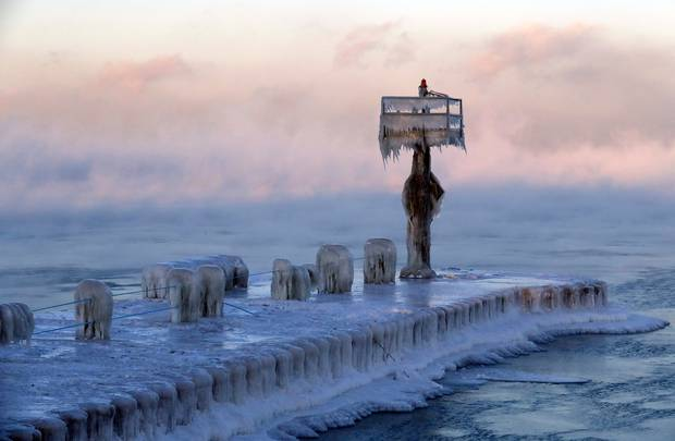 A harbor light is covered by snow and ice on the Lake Michigan at 39th Street Harbour. Photo / AP