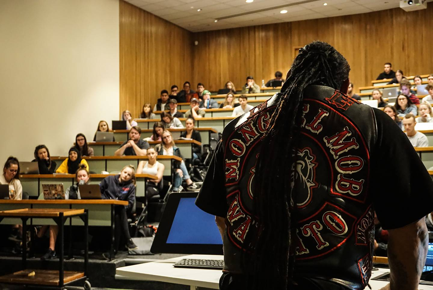 Sonny Fatu of the Hamilton Mongrel Mob chapter talks to Canterbury University criminal justice students on the university campus. Photo / Katie Harris