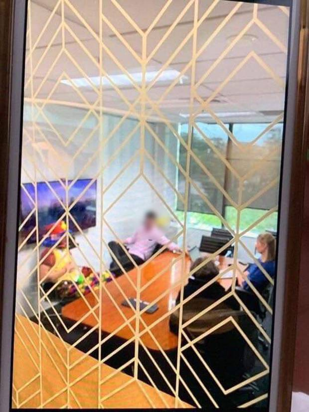 The image sent into the Herald shows the meeting taking place. The face of the staffer has been blurred to protect his identity. Photo / Supplied