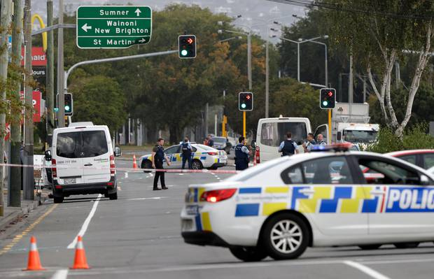 Police block the road near the shooting at a mosque in Linwood, Christchurch yesterday. Photo / AP