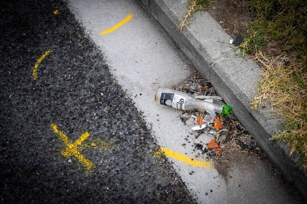 Paint marks a location in Clayburn Rd, Glen Eden, where a number of people were injured after a collision with a car outside a party on Sunday morning. Photo / Jason Oxenham.