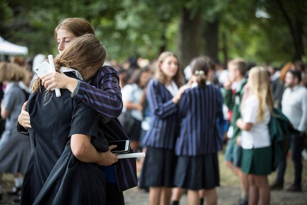 Student comfort each other at the vigil. Photo / Michael Craig