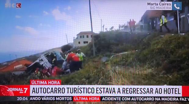 First responders at the scene of the tourist bus crash on the Portuegese island of Madeira.