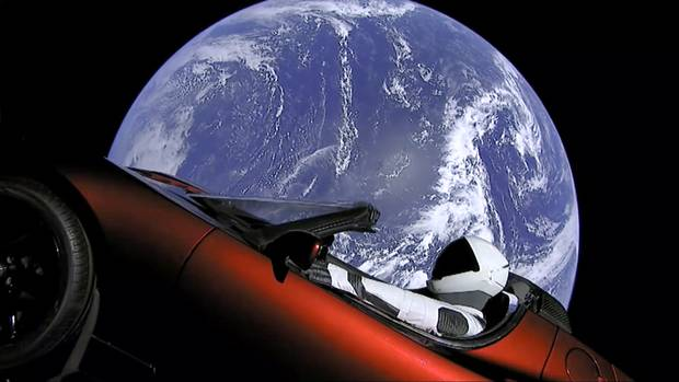 The company's shares jumped 3 per cent to close at US$345 today after SpaceX successfully launched its Falcon Heavy rocket with Musk's cherry red Roadster as its cargo. Picture / AP