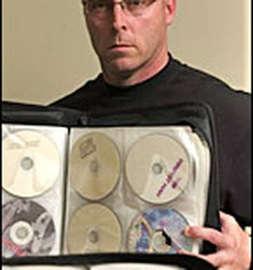 Watchdog sues 14 for sales of pirated DVDs - NZ Herald