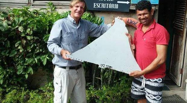 Blaine Gibson and a local investigator hold up the famous 'No Step' fragment. Photo / Blaine Alan Gibson / Facebook / Supplied