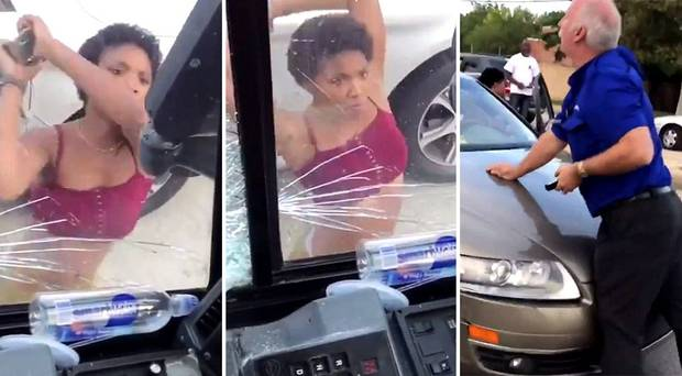 Police have arrested a woman who smashed the windows of a stopped bus involved in a road rage incident on Thursday. Photo / Twitter