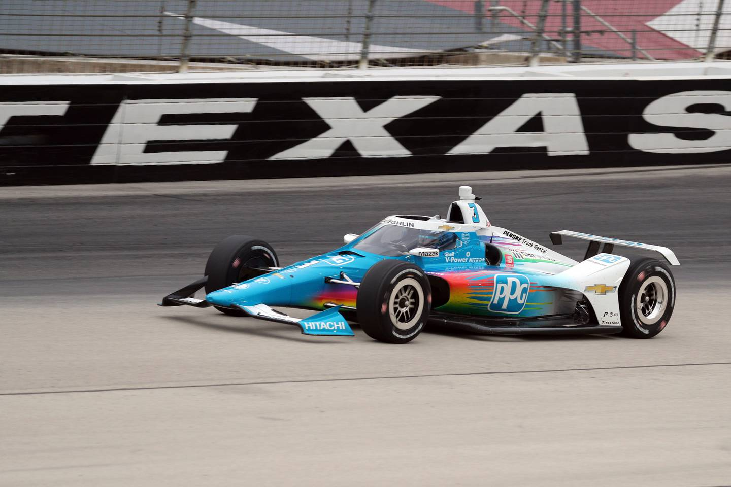Scott McLaughlin drives out of Turn 4 during the IndyCar Series auto race at Texas Motor Speedway. Photo / AP