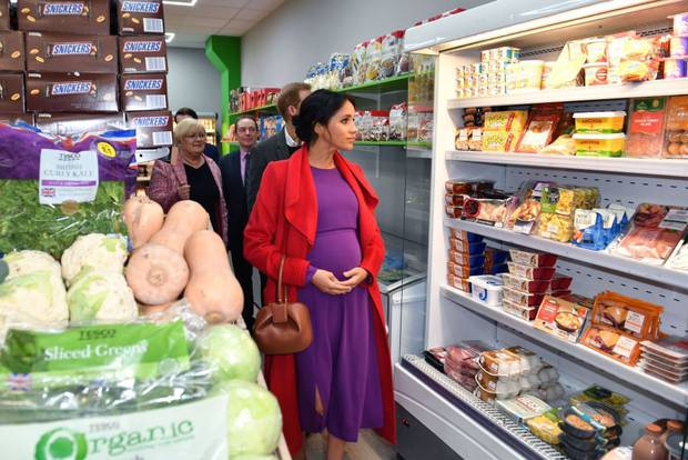 The Duke and Duchess of Sussex view the mini supermarket as they officially open Number 7, a Feeding Birkenhead citizens supermarket and community cafe. Photo / Getty Images