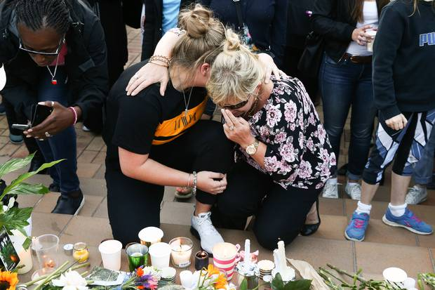 Members of the public pay their respects during a vigil for British backpacker Grace Millane at Civic Square in Wellington. Photo / Getty Images