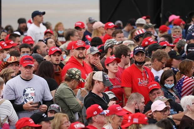 Supporters wait to see President Donald Trump. Photo / Getty Images