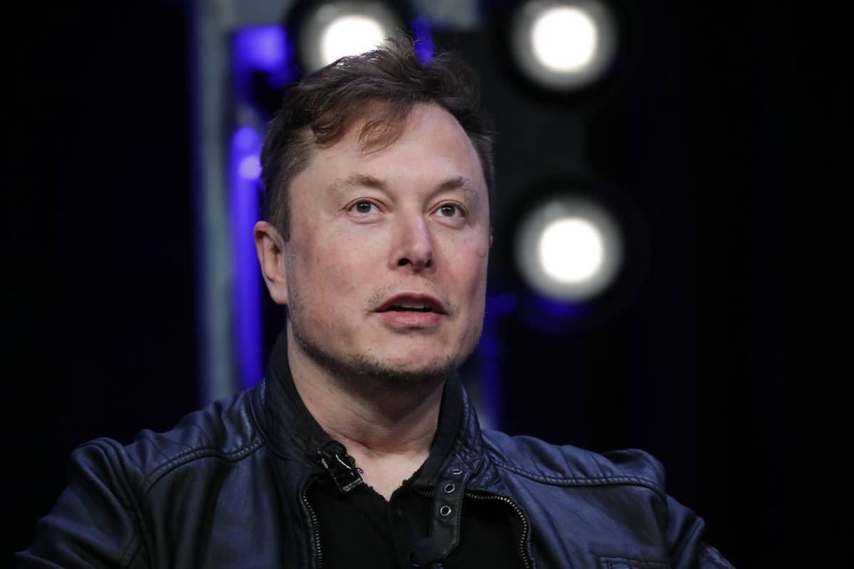Elon Musk claims he was 'photobombed' by Ghislaine Maxwell