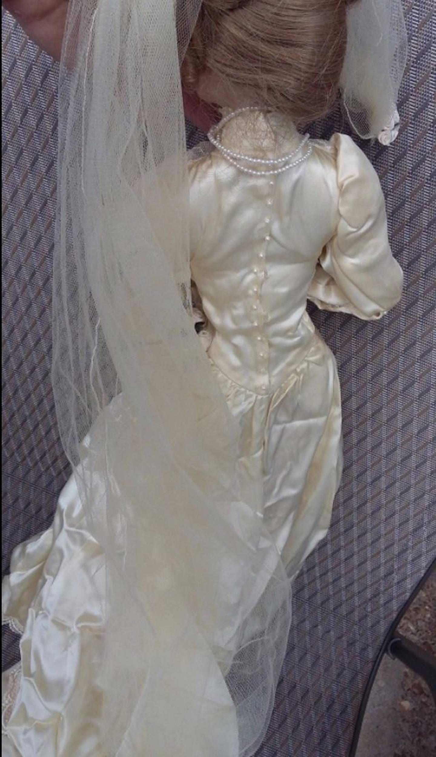 The back of the creepy doll, which Mrs Merrick thinks is haunting her home after her husband got scratch marks.