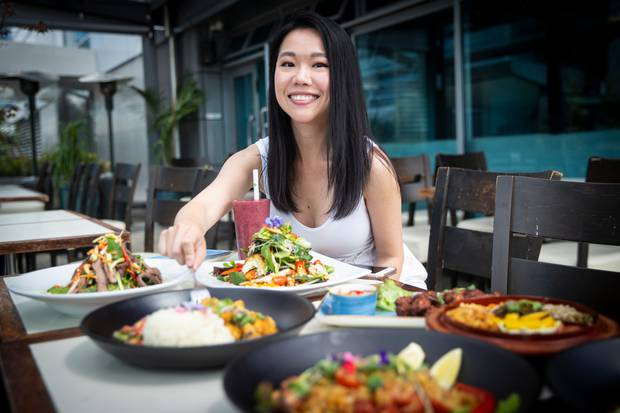 Melissa Koh, a food blogger who goes by the name of Melicacy on Instagram, says restaurant meals these days don't start until pictures are taken on smart phones. Photo / Jason Oxenham