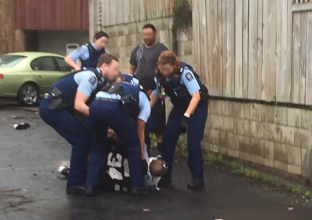 Police arrest a man in Beresford St, Central Auckland July 1. The man was Tasered several times and was taken to hospital where he passed away on July 4. Photo / NZ Herald