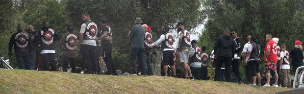 Head Hunter gang members gather at the funeral. Photo / Alan Gibson