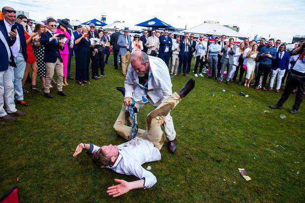 Race-goers enjoy the atmosphere after the 2019 Melbourne Cup Day at Flemington Racecourse. Photo / Getty Images