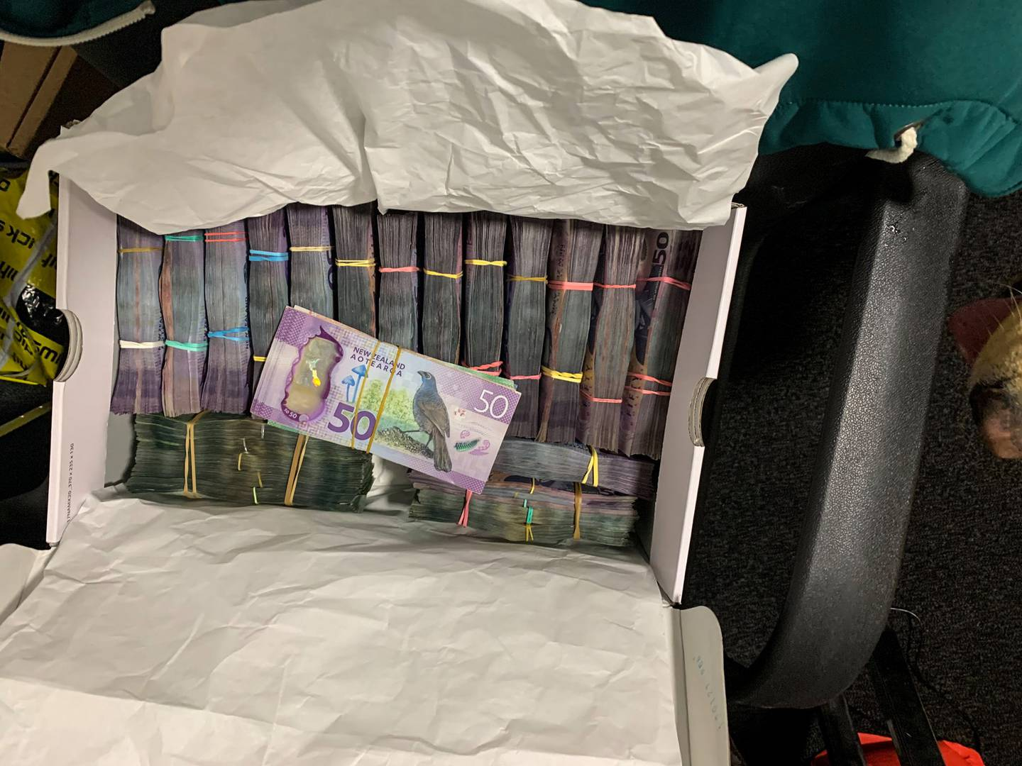 35 people were arrested in New Zealand as part of Operation Trojan Shield, and cash, drugs seized. Photo / NZ Police
