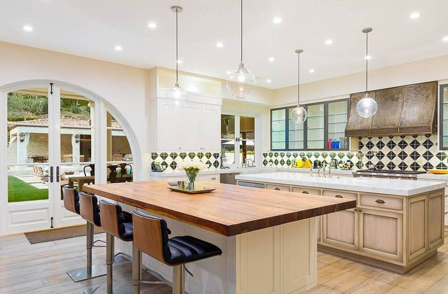 The couple can perfect roasting chickens in this large kitchen. Photo / VRBO/ Planet photos