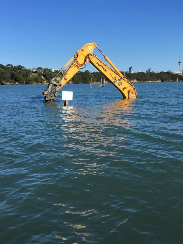 Other pictures showed the machinery mostly submerged underwater as the tide changed. Photo / Facebook