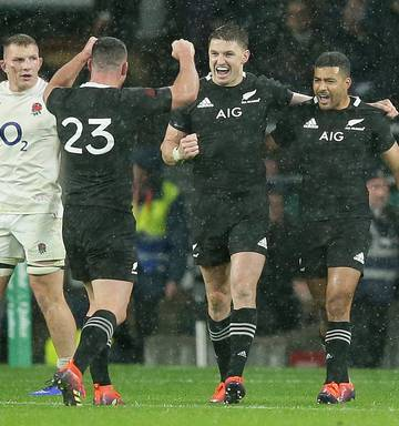 9ed9081933d ... New Zealand's Beauden Barrett, second right, celebrates with Ryan  Crotty, second left,