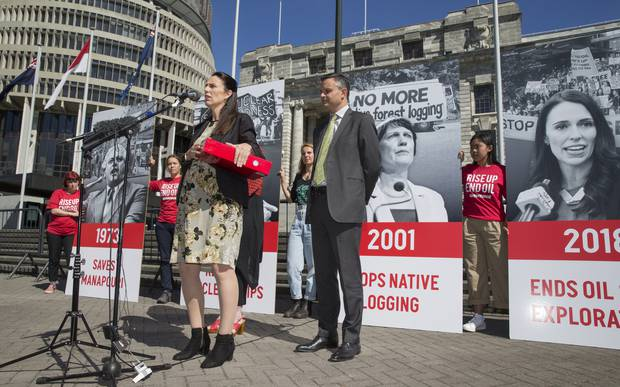 Prime Minister Jacinda Ardern, with Climate Change Minister James Shaw, speaking after receiving the End Oil petition from Greenpeace NZ at Parliament. Photo / Mark Mitchell