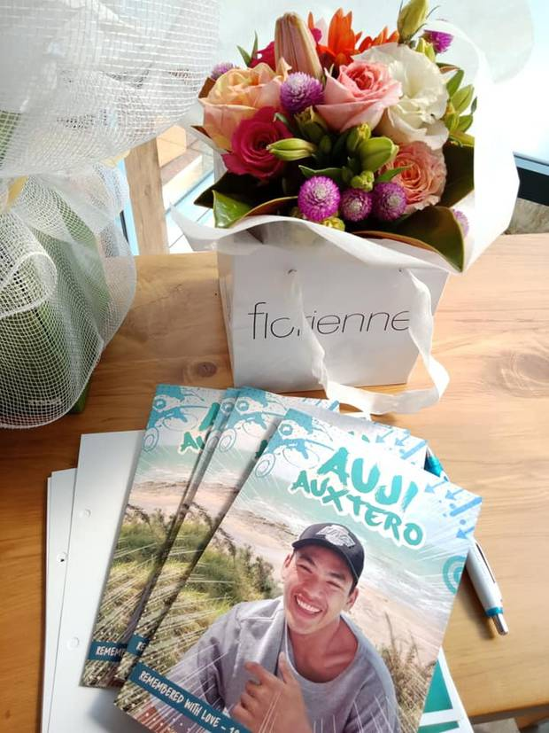 The memorial booklet for the funeral of Auji Auxtero. Photo / Supplied.