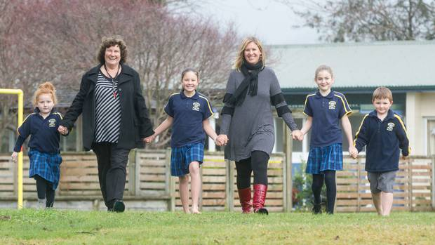 St Michael's Catholic School pupils with their teachers Marion Brits (second from left) and Rachael McLanachan (centre). Photo/Stephen Parker.
