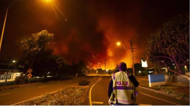 Fire and Rescue teams fight a wild bushfire as it approaches Peregian Beach township. Photo / news.com.au