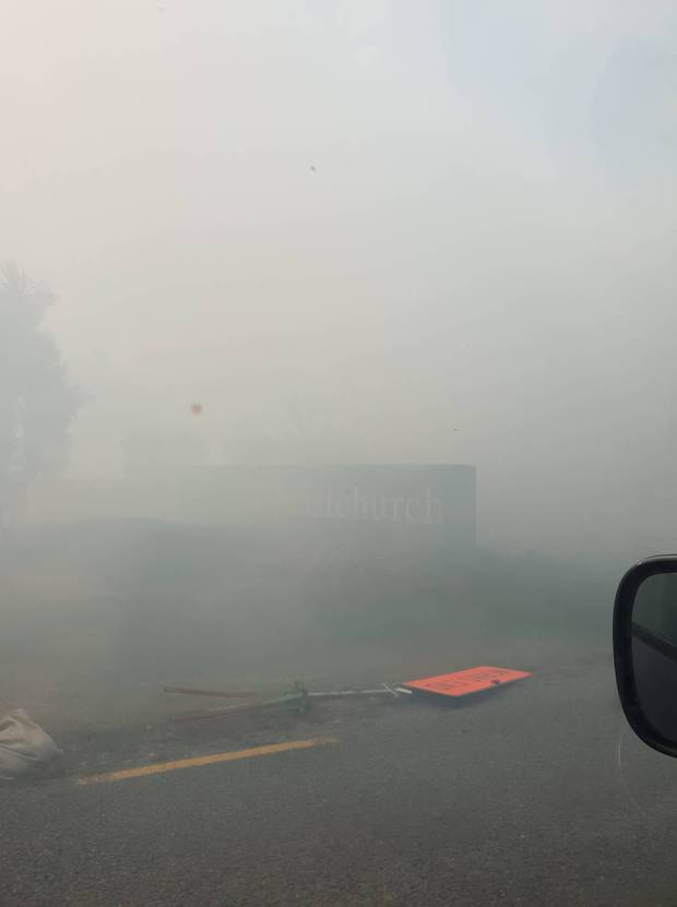Smoke has drifted over the motorway, forcing its closure. Photo / Melanie Stevenson