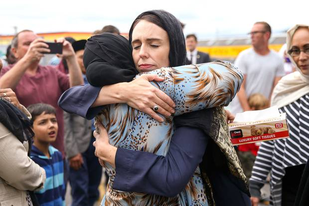 Prime Minister Jacinda Ardern hugs a mosque-goer at the Kilbirnie Mosque on March 17