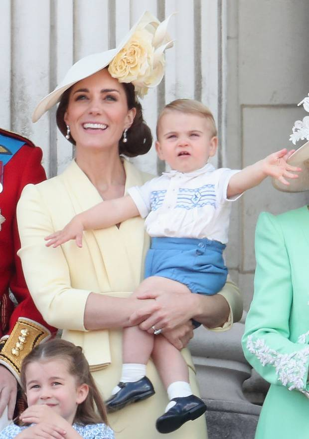 Catherine, Duchess of Cambridge holds Prince Louis while he waves at the crowds. Photo / Getty Images