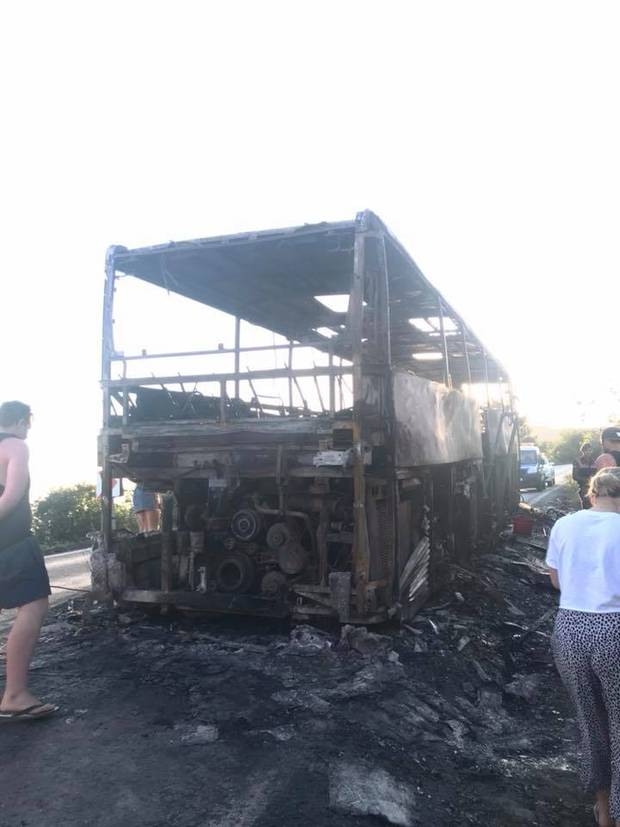 The bus went up in flames as tourists made their way to Anzac Cove. Photo / Laura Smith