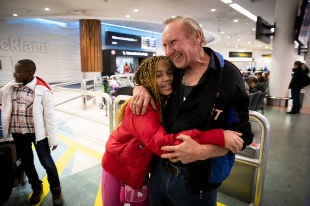 Mike Carruthers is reunited with his stepdaughter Saadia Moktari, 10. The family have been apart for 18 months. Photo / Dean Purcell