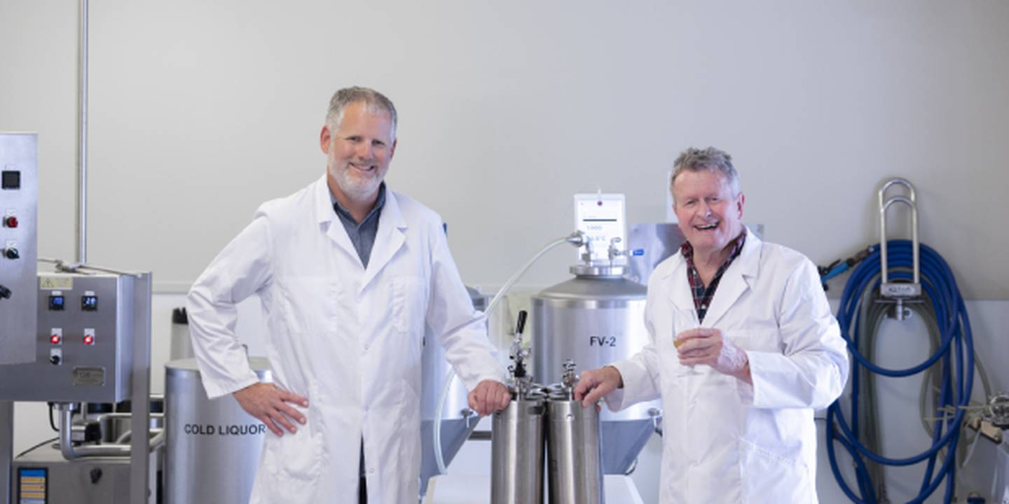 Kerry Templeton and Dr Ron Beatson in Plant & Food Research's pilot brewery. Photo / Supplied.