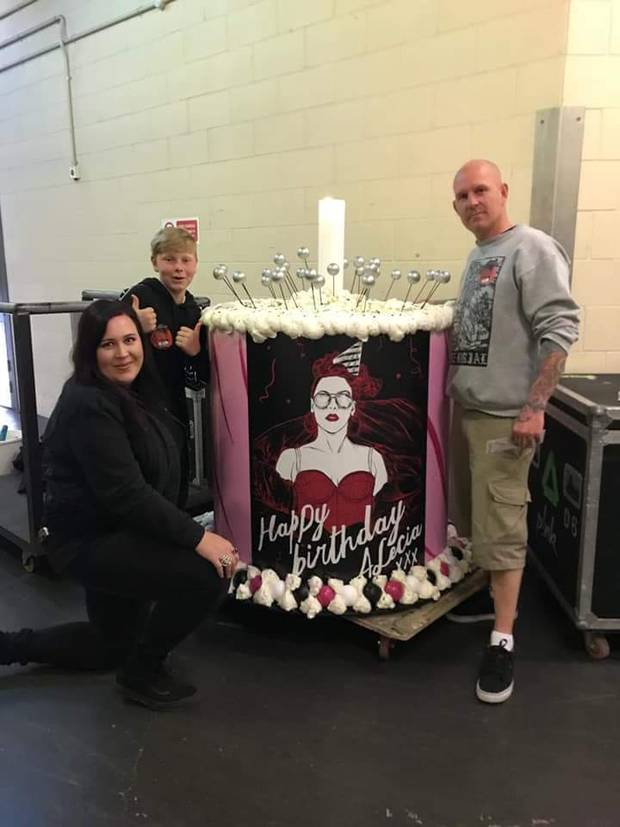 Ami Holifield, left, Connor Owen and Rhys Owen built a prop surprise birthday cake for Pink presented to her on stage durig her opening New Zealand show in Auckland. Photo/ Supplied.