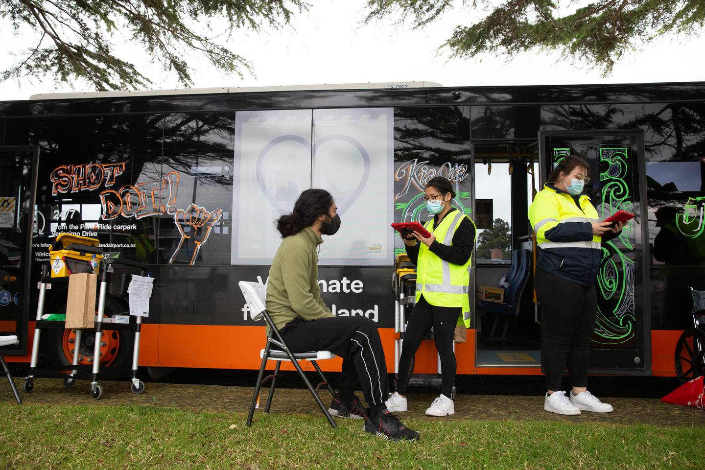 Lima Faatoina recieves his second dose at the 'Shot Doy' vaccination bus in Panmure, Auckland. Photo / Sylvie Whinray