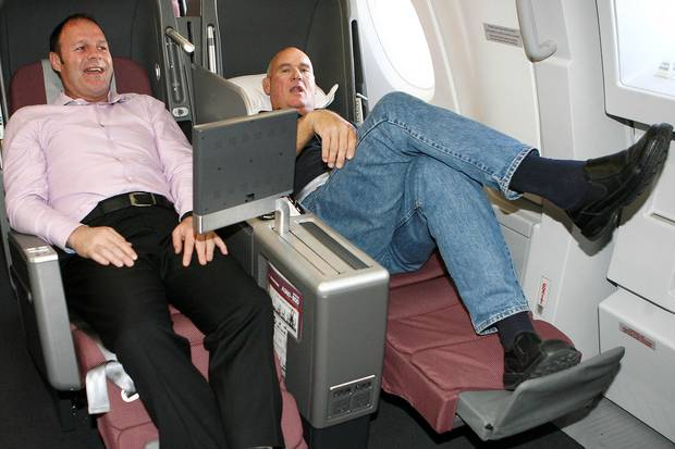 Former All Blacks Alan Whetton and Andy Haden stretch out in Business class on the Qantas Airbus A380, the worlds largest commercial aircraft, on its first visit to New Zealand in 2008. Photo / NZPA