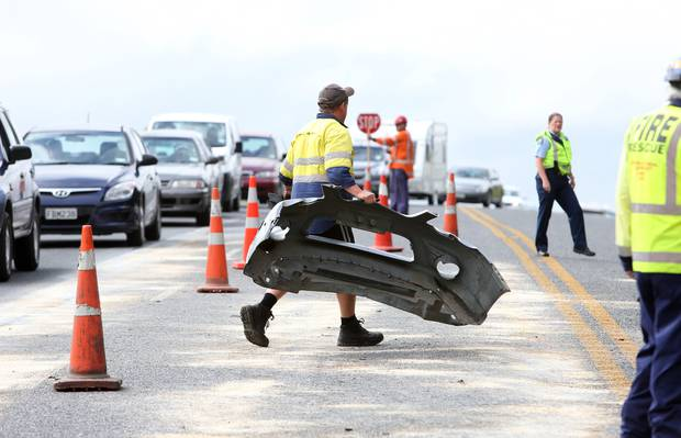 Part of a vehicle being removed from the road after a serious crash on Smeaton's Hill, Northland, 2016.