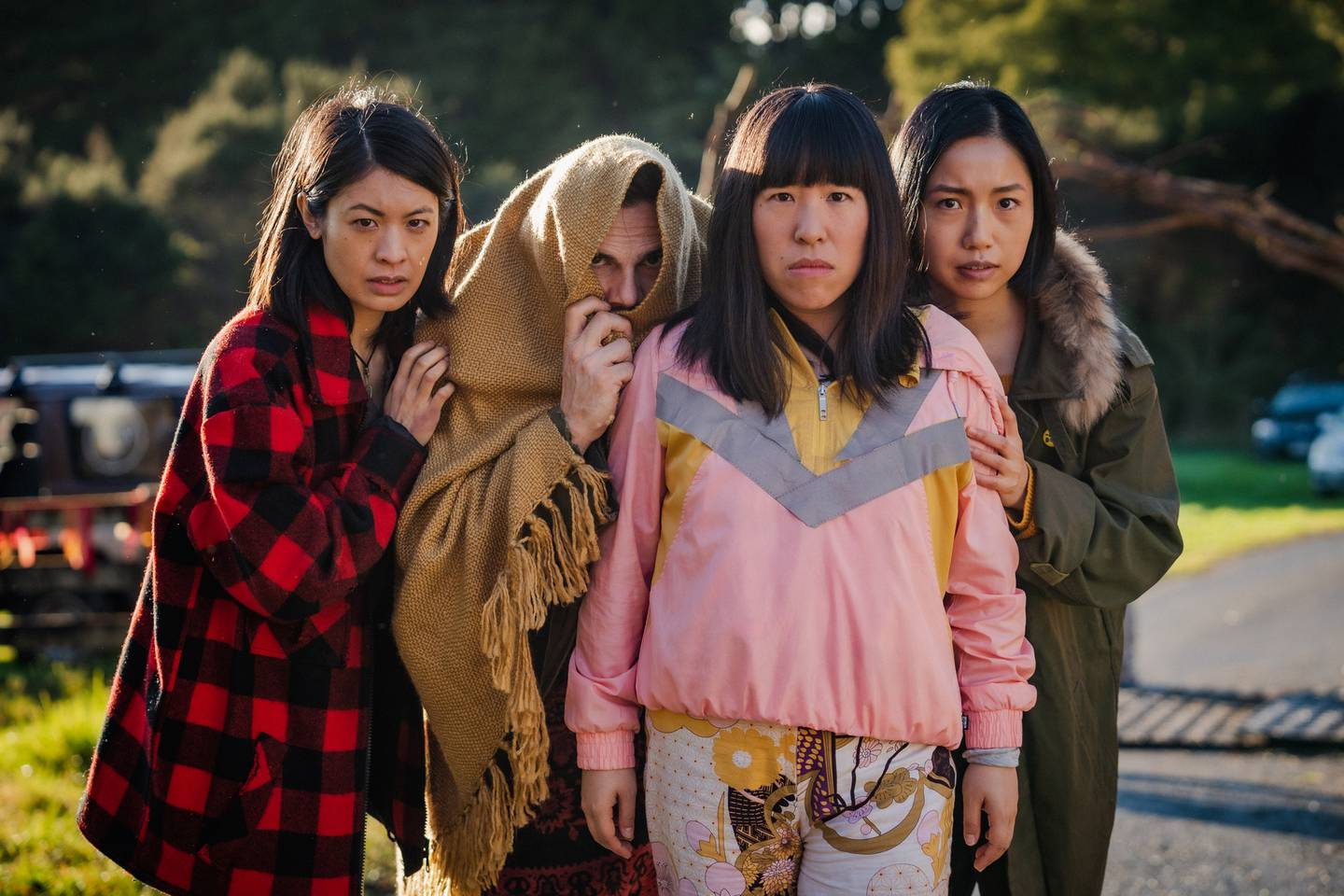 Flat3 Production's JJ Fong, Perlina Lau and Ally Xue pictured with Jay Ryan in a scene from Creamerie. Photo / TVNZ