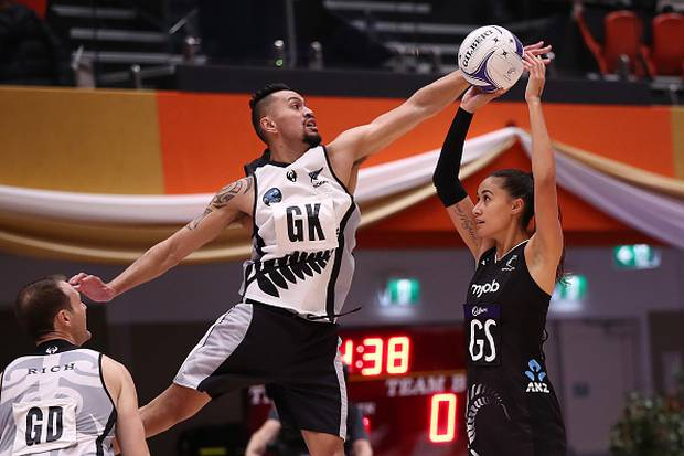 Matt Wetere of the NZ Men defends Maria Folau of the Silver Ferns. Photo / Getty