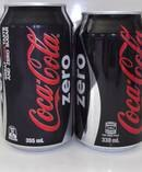 The size difference between the old 355ml can of coke in a pack and the new 330ml size. Photo / Supplied