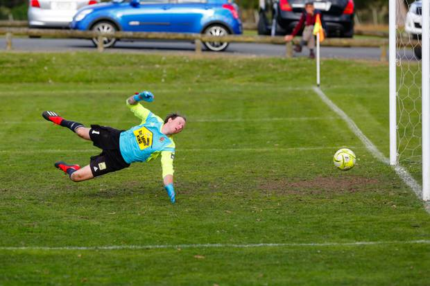 Havelock North keeper Nick Hayward watches and James Satherley's header goes on to hit the post. Photo/ Lewis Gardner